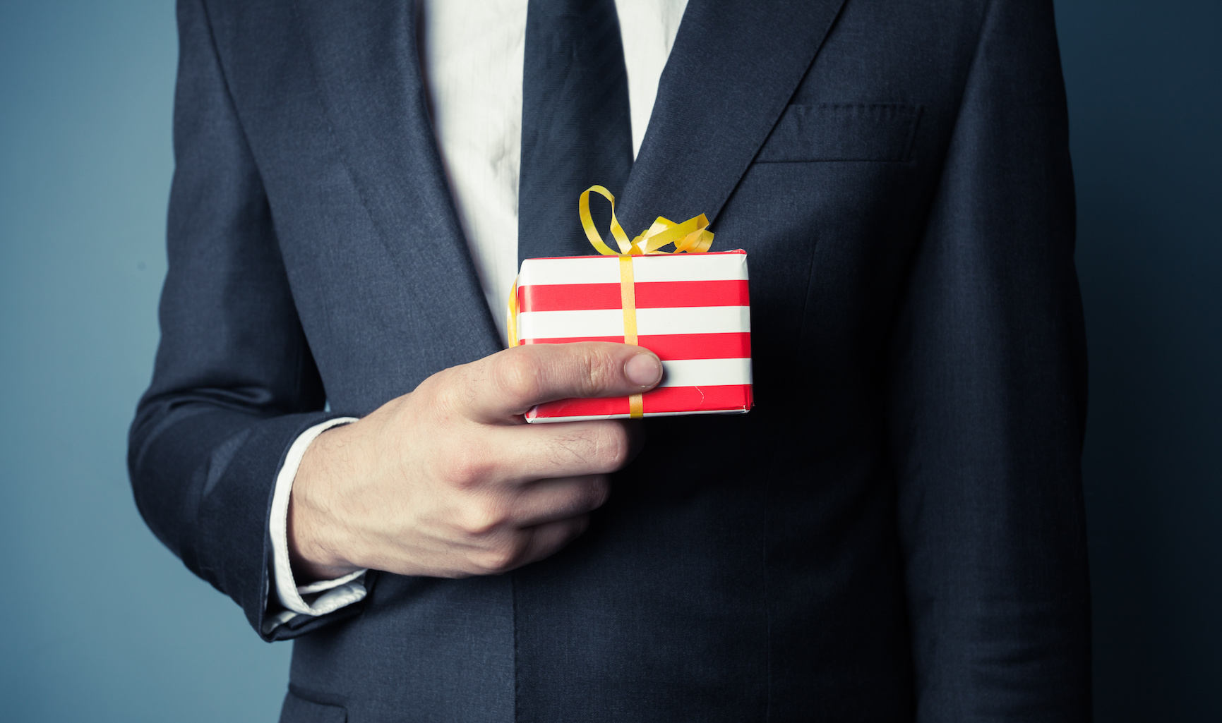 Businessman is holding a small gift
